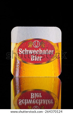 Wien,Austria-December 13,2014: Beermat from Schwechater beer.The history of the Schwechater beer started in the year 1632. Peter Descrolier founded the brewery in Schwechat. - stock photo