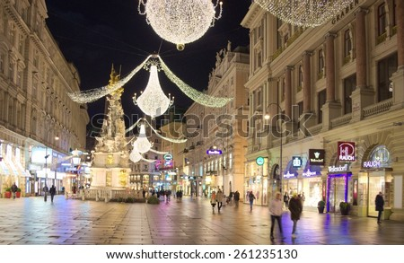 WIEN, AUSTRIA, JANUARY 3, 2015: people are walking through one of the main boulevards in wien - graben - during the night after new years eve. - stock photo