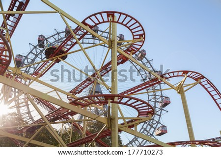 Wiener Riesenrad Ferris Wheel and Roller Coaster in the Prater amusement park in Vienna, Austria