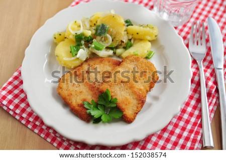 Wiener Schnitzel - fried pork chop  - stock photo