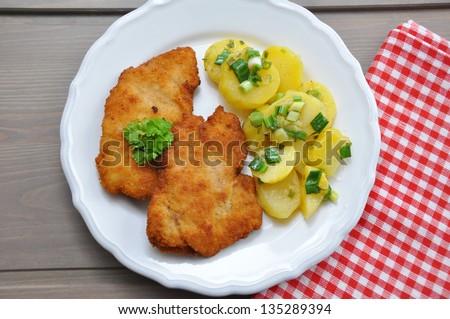 Wiener Schnitzel with potato salad - stock photo