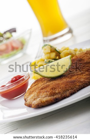 wiener schnitzel with potato salad  - stock photo
