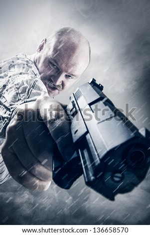 Wierd Gangster with gun and mustache in smoke and snow. Holding a gun. - stock photo