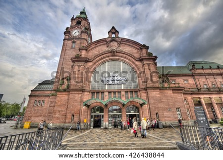 Wiesbaden, Germany - April 29, 2014: People walk in front of the historical railway station of Wiesbaden, Germany on April 29, 2014