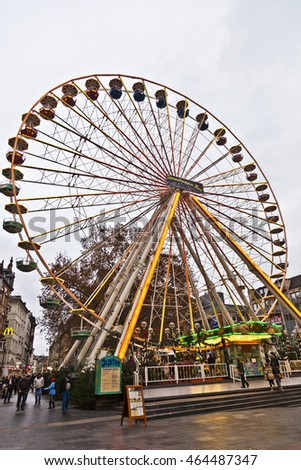 WIESBADEN, GERMANY - DEC 4, 2011: big wheel in motion with clouds at the Sternschnuppen  christmas market  in Wiesbaden, Germany. The market is open from November 22 until December 23, 2011.