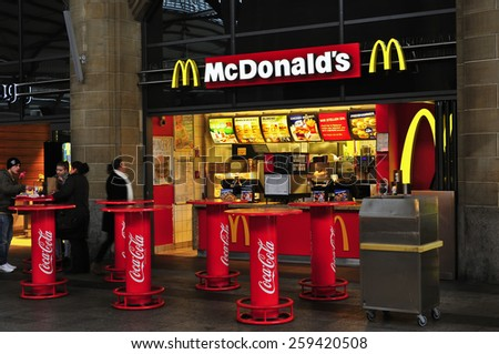WIESBADEN,GERMANY-FEB 18: McDonald's Restaurant on February 18,2015 in Wiesbaden,Germany.  The McDonald's Corporation is the world's largest chain of hamburger fast food restaurants. - stock photo