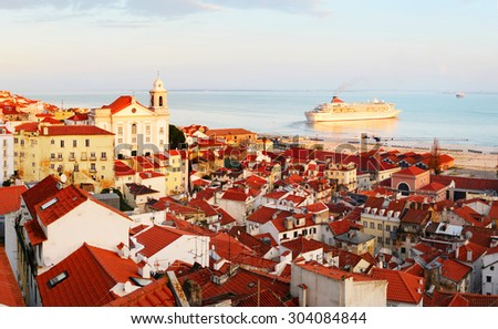 Wiew of Lisbon Old Town and departuring cruise liner at sunset, Portugal - stock photo