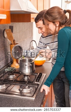 Wife and Husband Cooking Together in the Kitchen