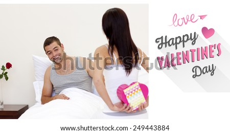Wife giving her husband a valentine against cute valentines message - stock photo