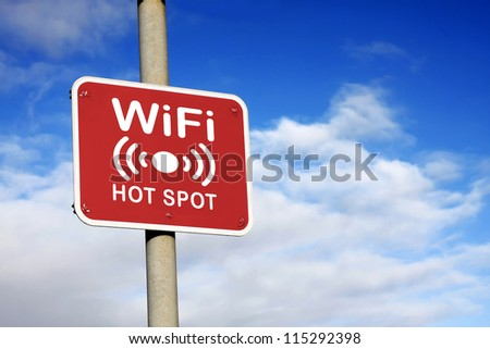 WiFi hotspot sign against a blue sky - stock photo