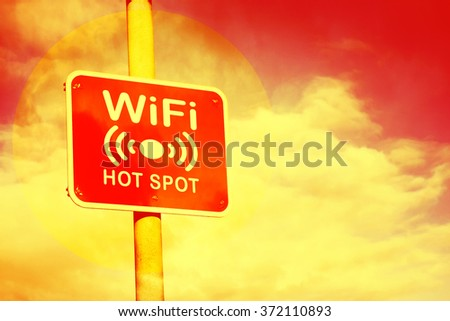 Wifi hotspot sign against a hot red and yellow background
