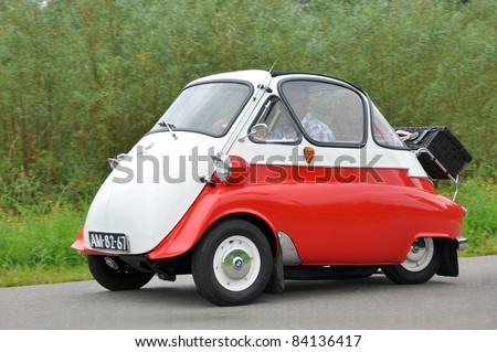 WIJHE, THE NETHERLANDS - SEPTEMBER 4: A BMW Isetta 300 from 1955 drives past at the 10th Diekdaegen classic car tour on September 4, 2011 in Wijhe, The Netherlands - stock photo