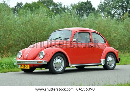 WIJHE, THE NETHERLANDS - SEPTEMBER 4: A Volkswagen Beetle 112111 from 1984 drives past at the 10th Diekdaegen classic car tour on September 4, 2011 in Wijhe, The Netherlands - stock photo