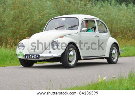 WIJHE, THE NETHERLANDS - SEPTEMBER 4: A Volkswagen Beetle 111011 from 1969 drives past at the 10th Diekdaegen classic car tour on September 4, 2011 in Wijhe, The Netherlands
