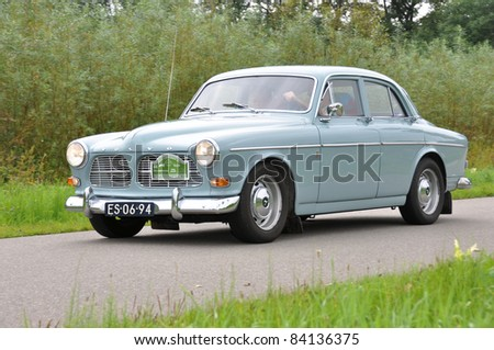 WIJHE, THE NETHERLANDS - SEPTEMBER 4: A Volvo Amazon P12194 from 1965 drives past at the 10th Diekdaegen classic car tour on September 4, 2011 in Wijhe, The Netherlands