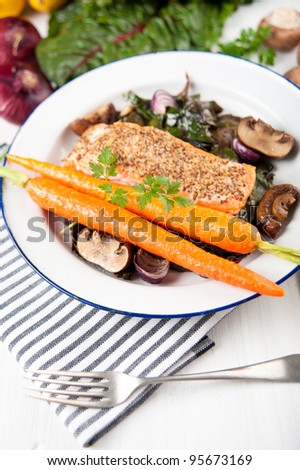 Wild Alaskan Salmon Grilled with Mustard and Served on Wilted Swiss ...