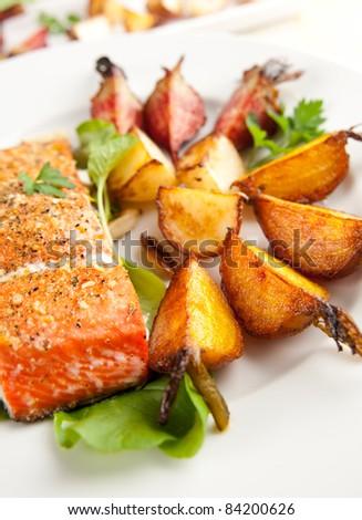 Wild Alaskan Sockeye Salmon Baked with Various Root Vegetables - stock photo