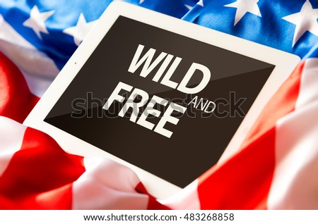 Wild and Free on tablet and the US flag