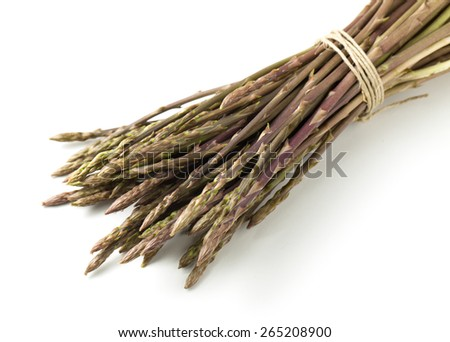Wild asparagus spears in bunch isolated on white - stock photo