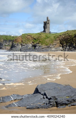 wild atlantic way castle and beach in Ballybunion county Kerry Ireland - stock photo