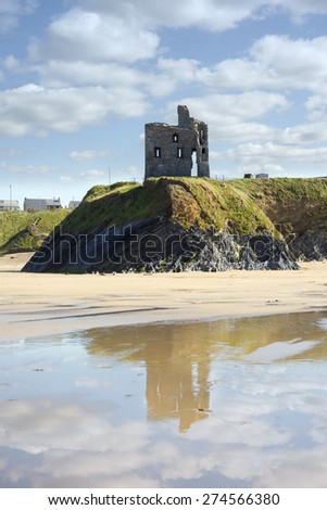 wild atlantic way castle and beach with beautiful reflection of the clouds - stock photo