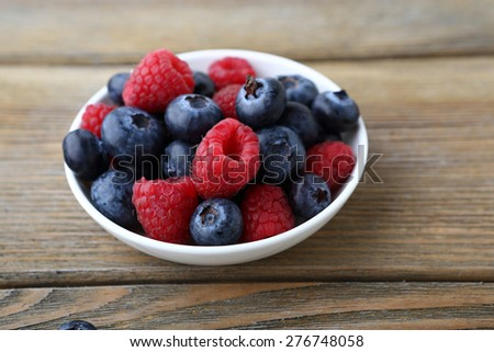 Wild berries on a plate, food - stock photo