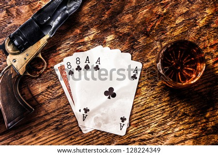 Wild Bill Dead Mans Hand with a whiskey shot and a colt revolver