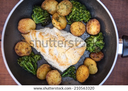 Wild Black Cod Sauteed Fillet Served with Potatoes and Broccoli  - stock photo