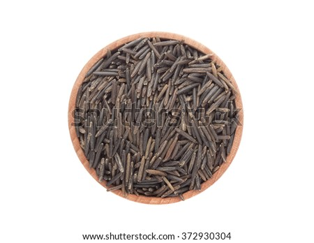 Wild black rice in wooden bowl isolated on white background, top view