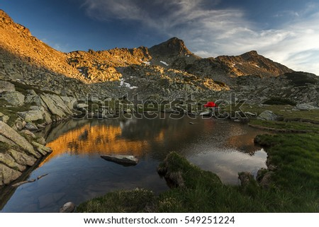Wild camping neara a lake in a beautiful mountain landscape at sunset, Pirin Mountain, Bulgaria