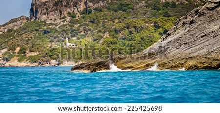 Wild coast and church, Potami, Samos island, Aegean archipelago, Greece - stock photo