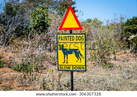 Wild Dog sign in northern Zimbabwe, Africa - stock photo