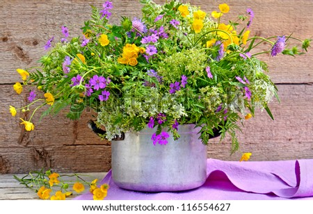 wild flowers in an old pot