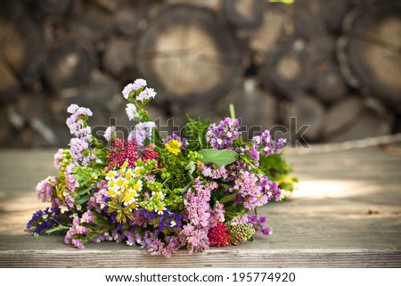 Wild flowers on  a grunge wood backdrop with copy space. Also available in vertical format.  - stock photo
