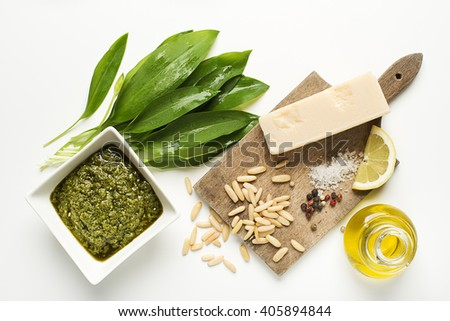 Wild garlic pesto ingredients on white background overhead shoot