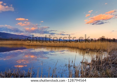 wild lake on the sunset light - stock photo