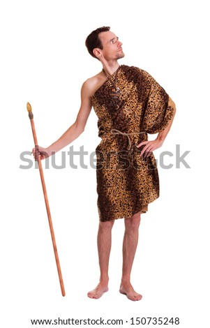 Wild man in animal fell with a spear isolated on white background - stock photo