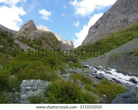 wild mountain stream in a steep slope between rocks - stock photo