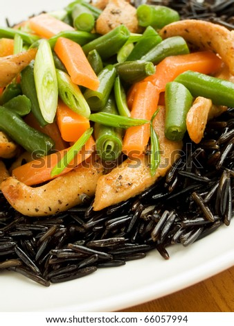 Wild rice with chicken and vegetables. Shallow dof.