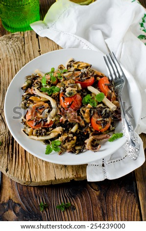 Wild rice with seafood and vegetables - stock photo