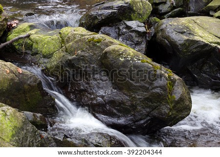 Wild River Falls ; Beautiful waterfall from mountain rivers overflowed cast down the rocky scenery - stock photo