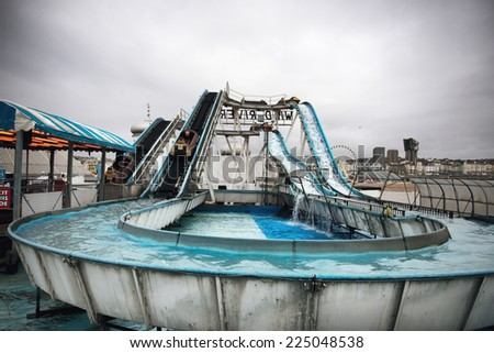 Wild River Log Flume Water Ride Under Cloudy Skies at Brighton Pier, Brighton, England - stock photo