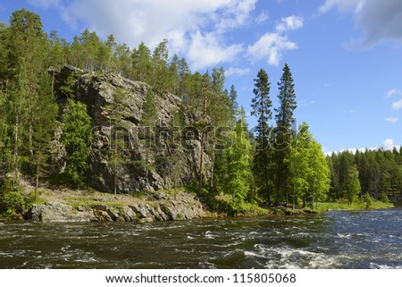 Wild River with rocky shores. Oulankajoki River. National Park Oulanka. northern Finland - stock photo