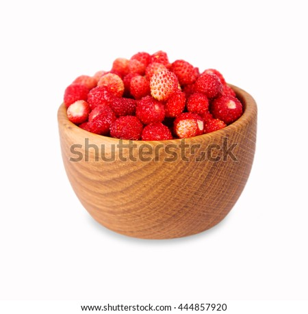Wild small strawberry in a wooden bowl. Ripe and tasty strawberry isolated on white background. Sweet and juicy berry. Berry useful for strengthening the immune system. - stock photo