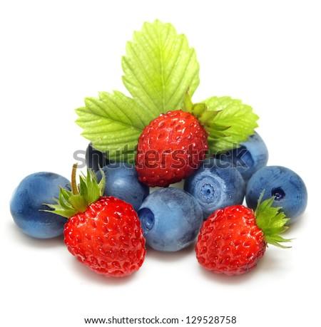 Wild strawberry and blueberry macro isolated on white - stock photo