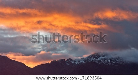 Wild sunset colors high in the mountains, Himalayas, Nepal - stock photo
