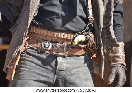 wild west cowboy with holster and revolver - stock photo