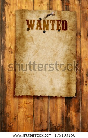 wild west wanted poster on wooden wall - stock photo