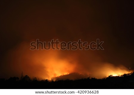 wildfire with long shutterspeed - stock photo