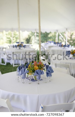 Wildflower Wedding Centerpieces With Black Eyed Susans Snapdragons And Delphinium On A Reception Table